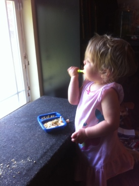 Feeding herself with her spoon